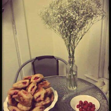 Sour cherry sufgainyot (Jewish doughnuts)