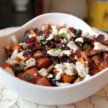 Roasted sweet potato salad with onions, cranberries and nuts
