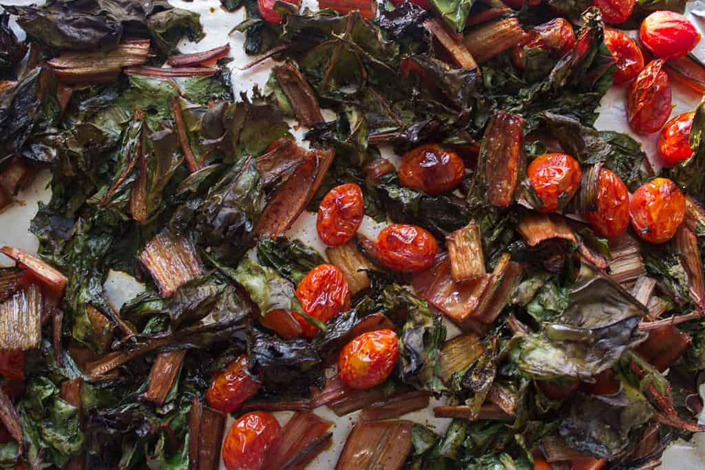 swiss chard and tomatoes out of the oven