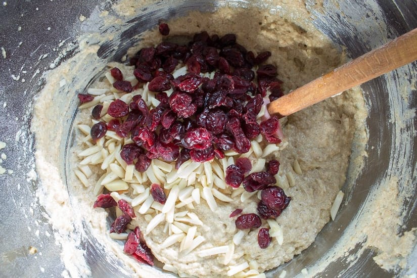 Adding cranberries and almonds for almond cranberry cake