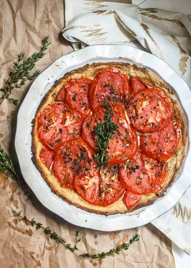Summer's last tomato tart - Encapsulated in a an olive-oil crust, this tomato tart is full of tangy (vegan) mayonnaise, sharp, grainy mustard, and the summer's last tomatoes.
