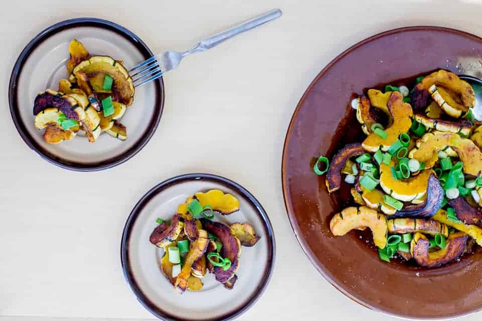 Roasted delicata squash salad with scallions and pumpkin seeds