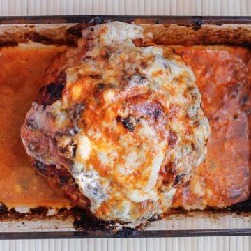 Whole roasted cauliflower in smoky tomato sauce