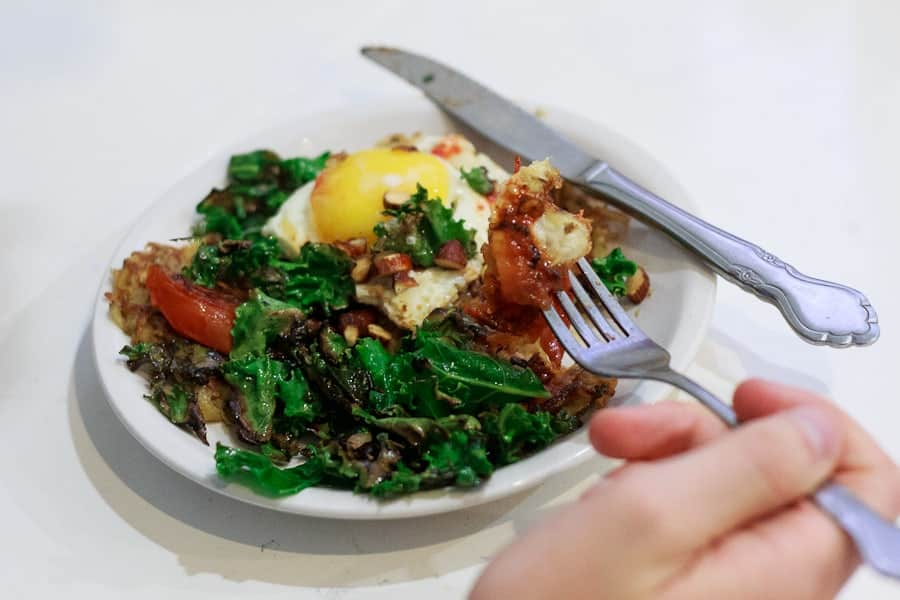 Potato latke topped with egg, kale, tomatoes and Tamari almonds