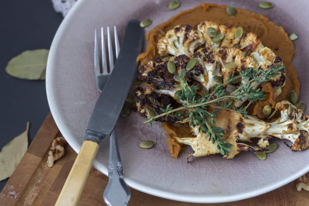 Roasted cauliflower steaks on spicy sweet potato puree