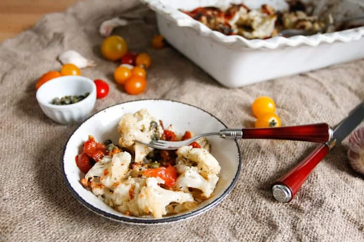 Roasted cauliflower with tomatoes and capers is caramelized, rich in flavour and glistening with sauce, a perfect dish to welcome you home or whip up on a weeknight.