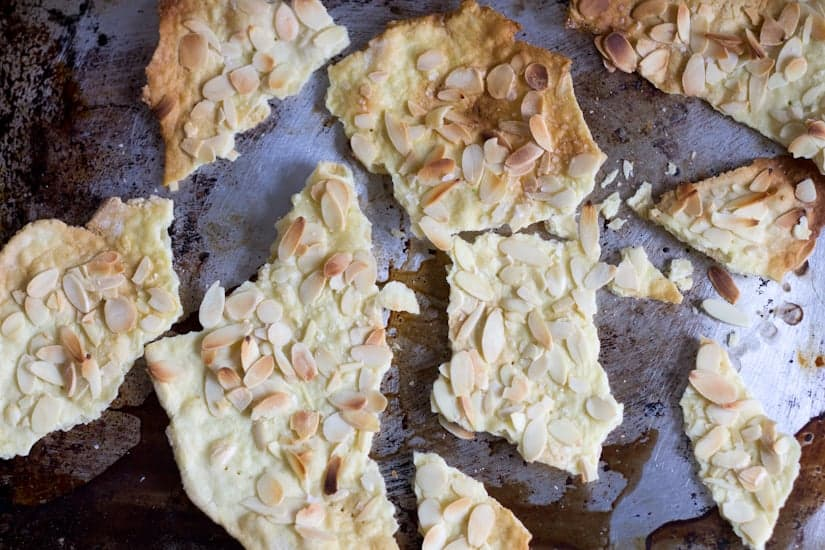 Crackly thin and sprinkled with a generous helping of almonds, gluten-free almond lavosh crackers go beautifully with the Middle Eastern appetizer platter.