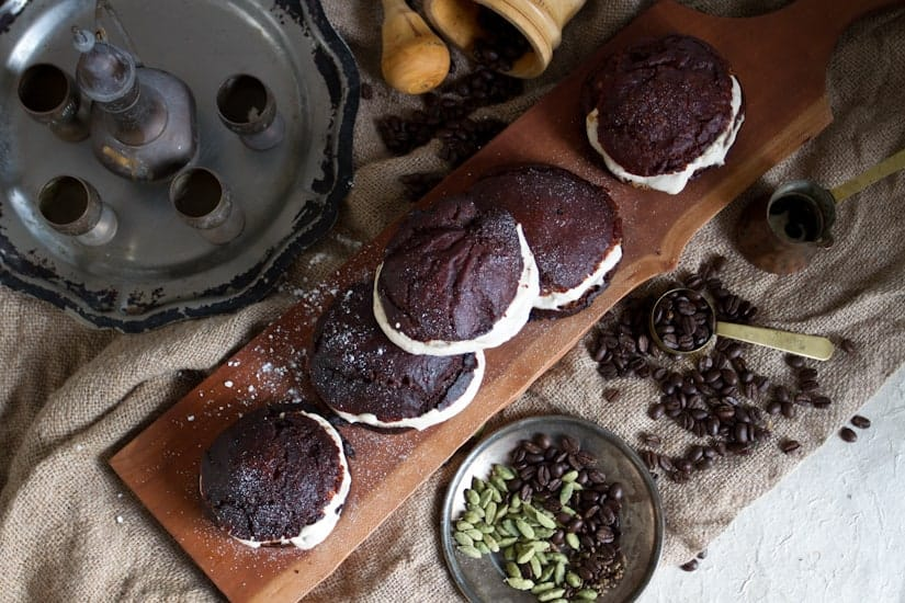 In these gluten-free sufganiyot with cardamom coffee cream, the coffee is paired with gently sweetened cream and piped into freshly fried Jewish donuts.