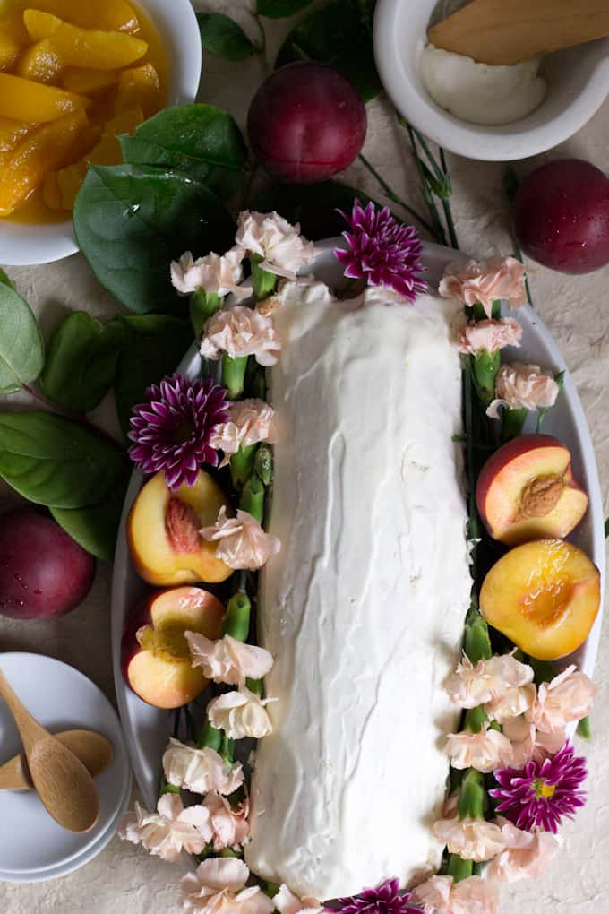 This gluten-free peach swiss roll cake is beautiful and special and oh-so-quaint, like a vision from the '80s making its way into modern life.