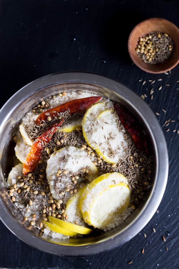 These spiced preserved lemons swim in a heady combination of chunky salt, fiery dried chilies, fragrant whole coriander seeds, and earthy whole cumin seeds.