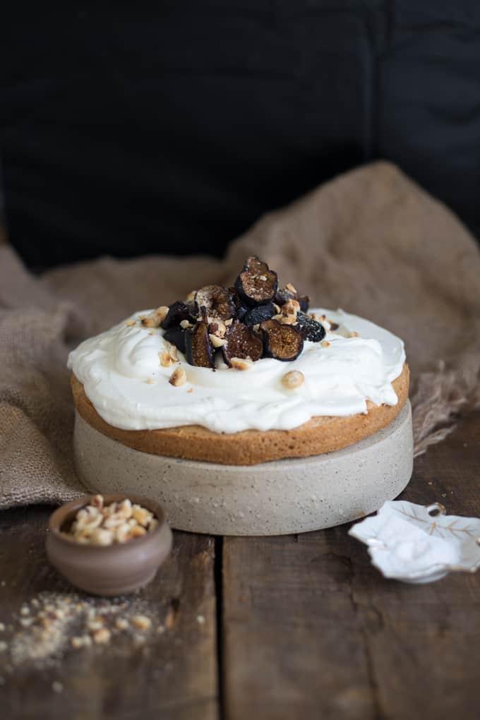 Almond vanilla cake with yogurt crema, caramelized figs and hazelnuts