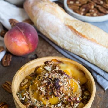 Baked brie with peaches, pecans, herbs and honey