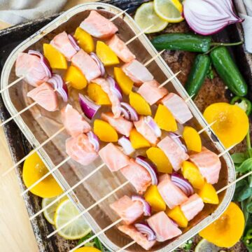 Peach salmon skewers with peach jalapeno crema