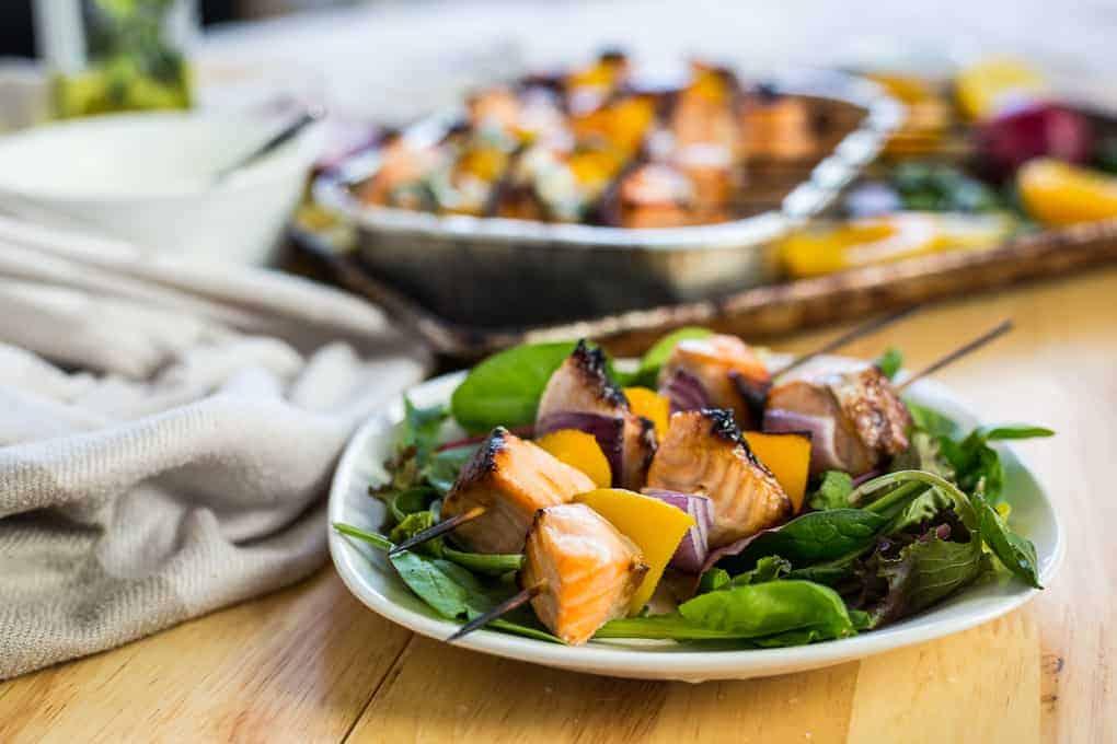 Peach salmon skewers with peach jalapeno crema