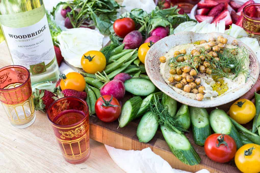 Recipes for easy springtime Middle Eastern entertaining with wine: spring hummus with crispy chickpeas, goat cheese with herbs and wine-soaked strawberries {GF, Veg, V}