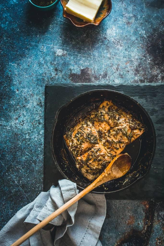 pan-fried Sockeye salmon recipe with mustard, honey and wild herbs with spoon