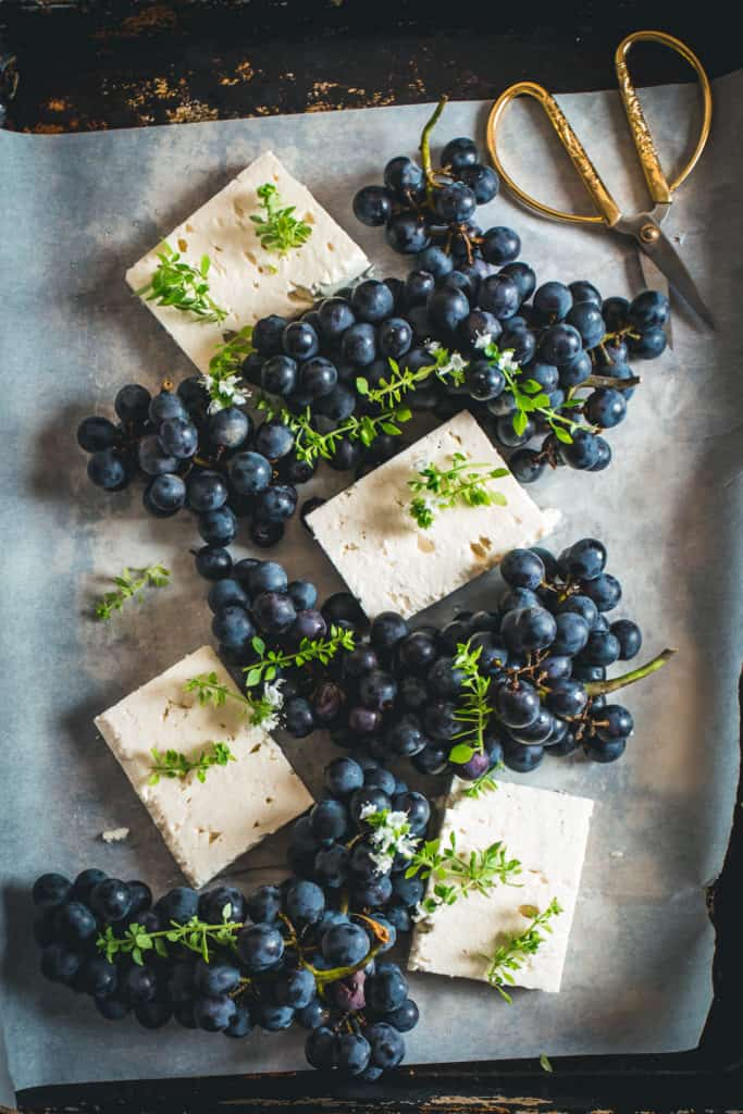 Tray with fresh feta and grapes