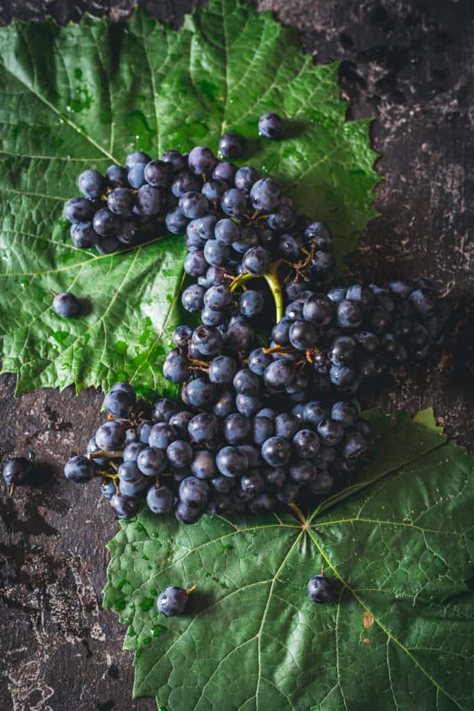 Grapes on grape leaves