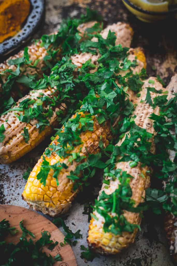 Middle Eastern grilled corn, served, close up