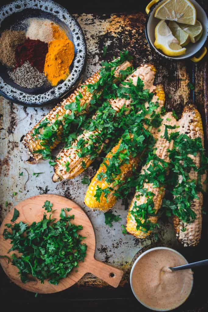 Middle Eastern grilled corn prepared, close up