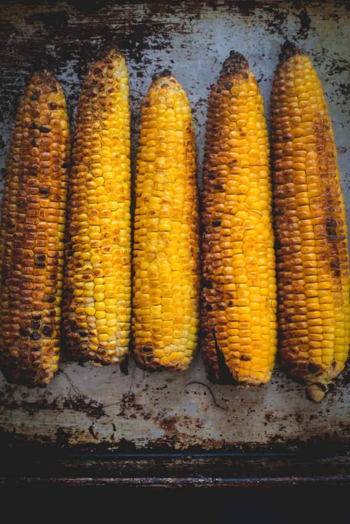 five corns laid out in a row, vertical