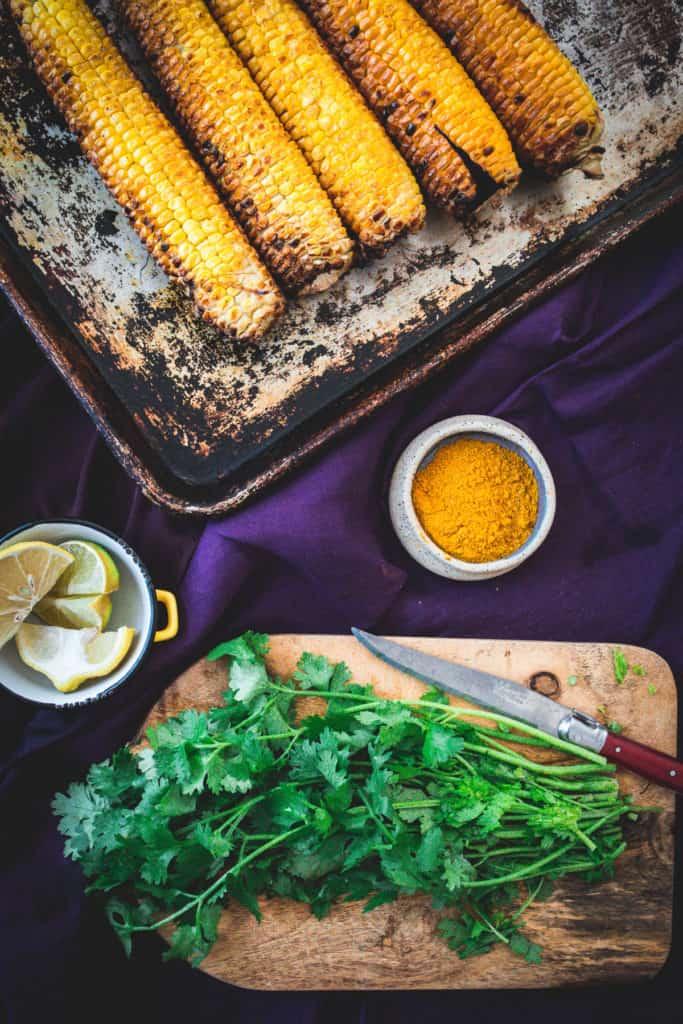 bird's eye view on cilantro, corn and sauces