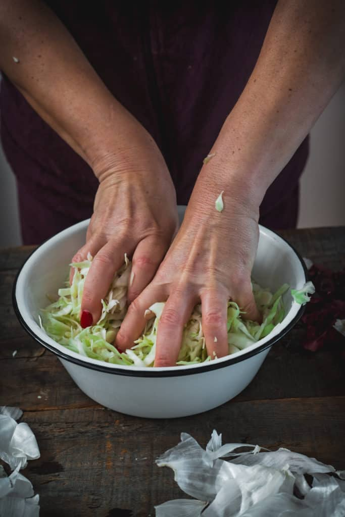 massaging cabbage for filling