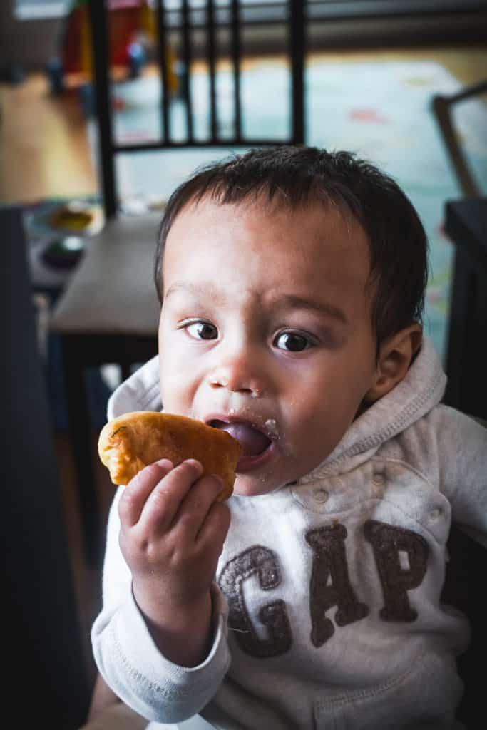 child eating russian vegetarian pirozhki