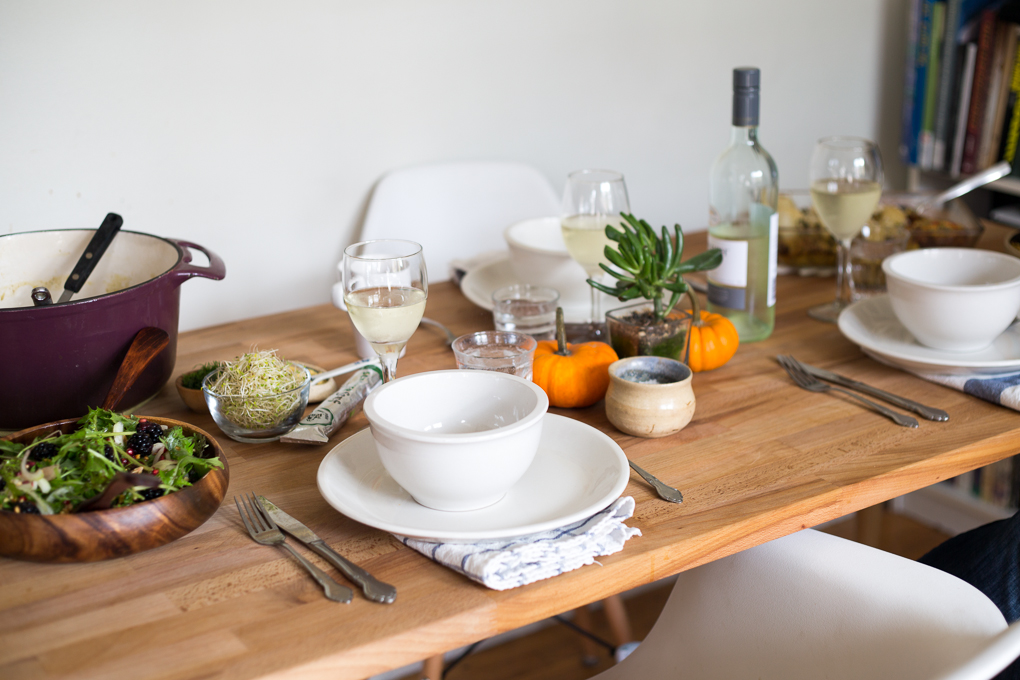 soup, salad and set table with wine