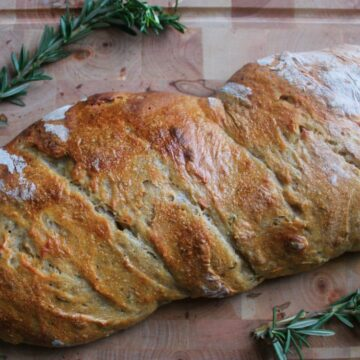 bread and two rosemary branches