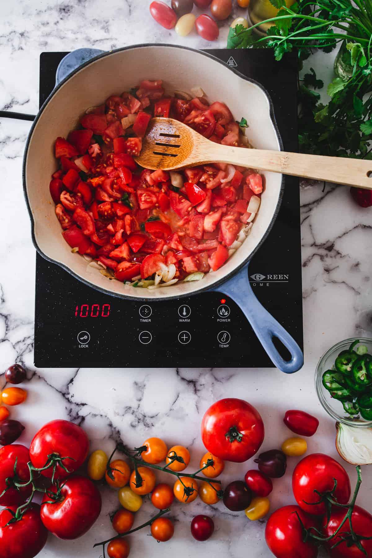 sauteeing tomato sauce for shakshuka