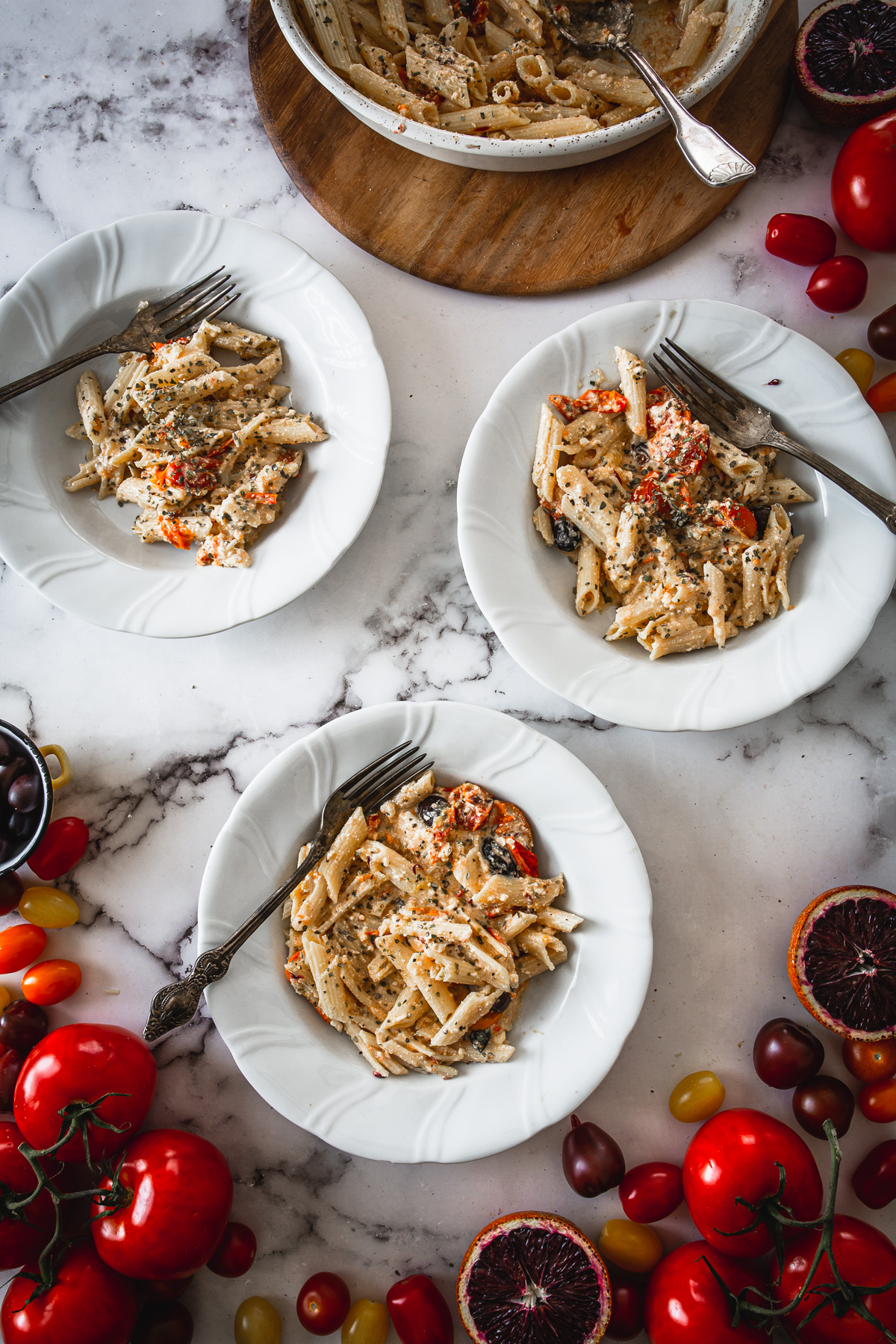 3 plates of baked feta pasta