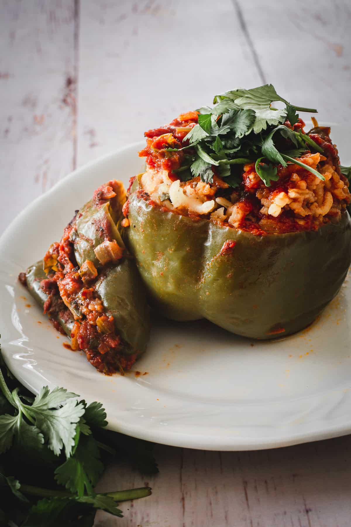 ground turkey stuffed green pepper on a plate