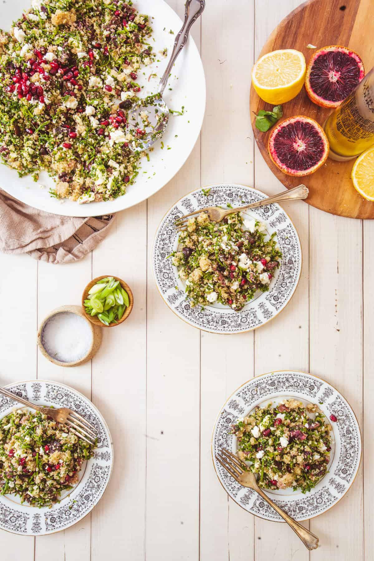 three plates of bulgur salad and one large platter of bulgur salad