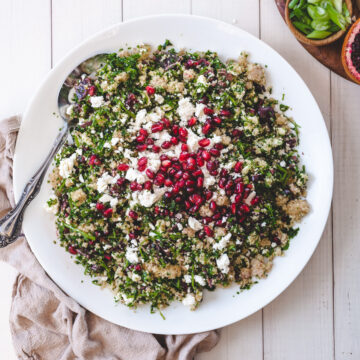 bulgur salad with feta, blood oranges, pomegranate seed in big bowl