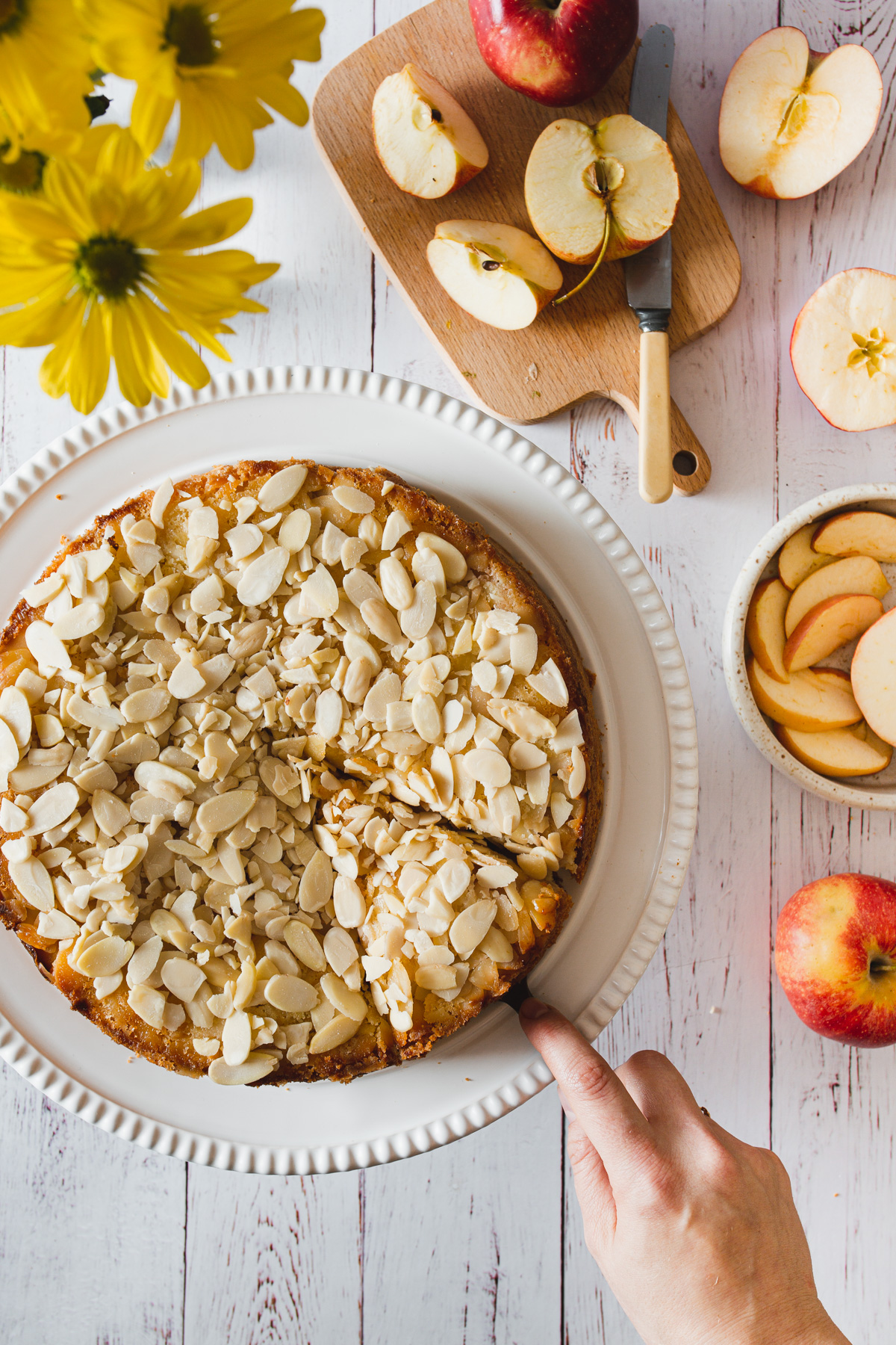 cutting a slice out of gluten free apple cake