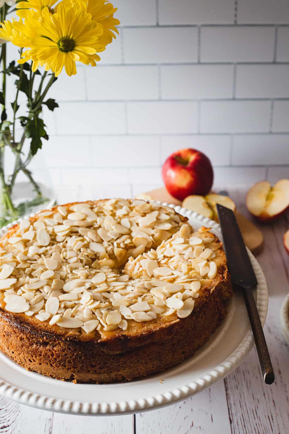 gluten free apple cake against yellow flowers backgdrop