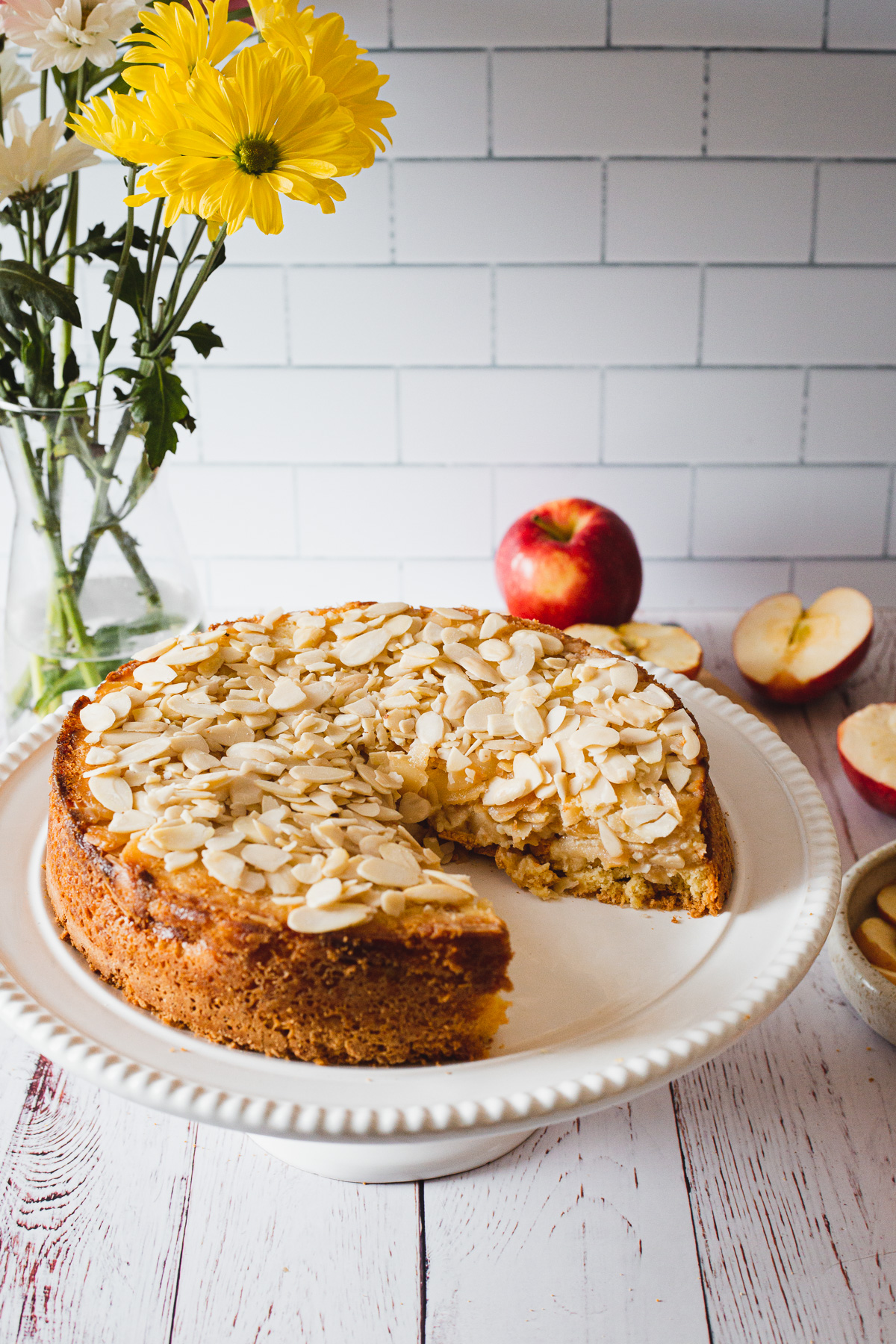 gluten free apple cake with a slice taken out