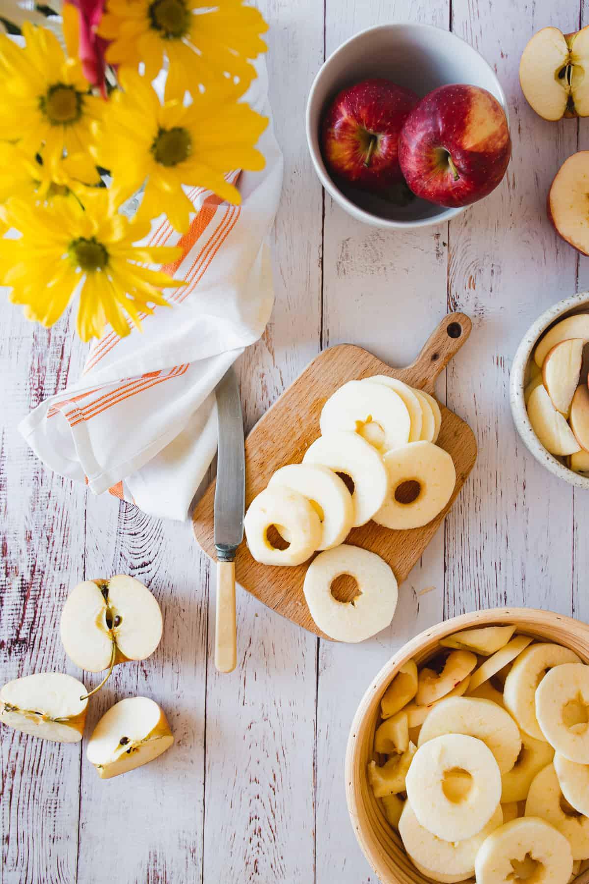 sliced Gala apples on cutting board