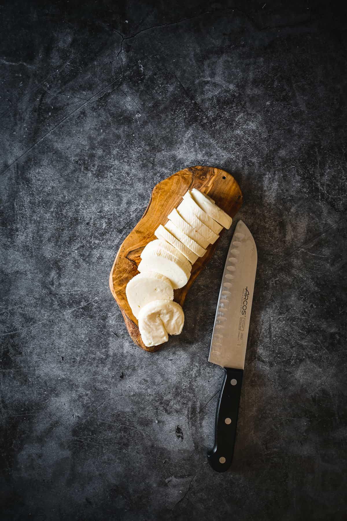 halloumi cheese on cutting board