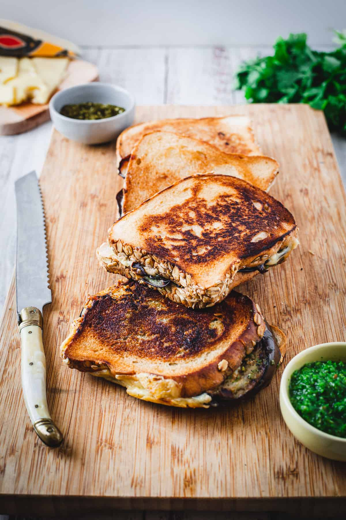 eggplant grilled cheese and knife on board