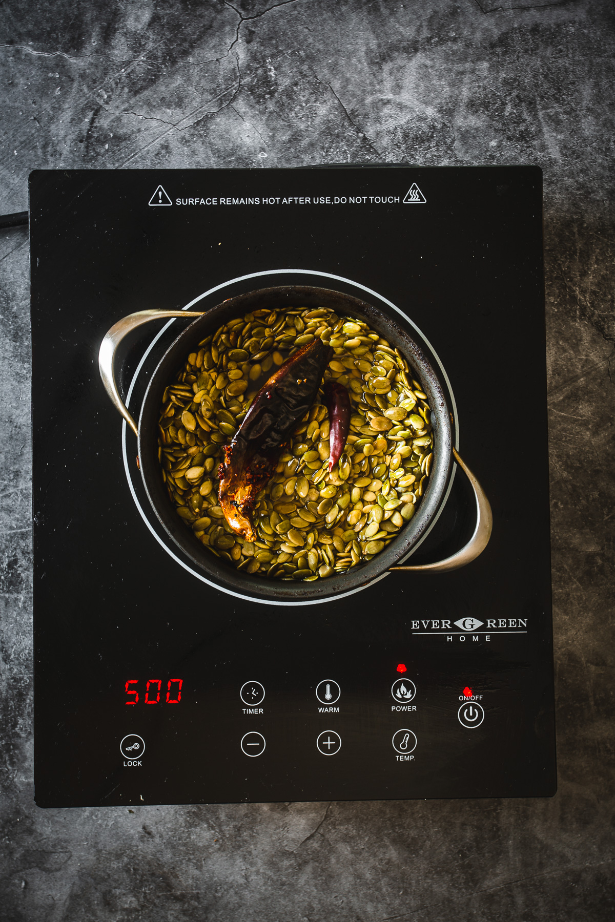 toasting pumpkin seeds and dried chillis