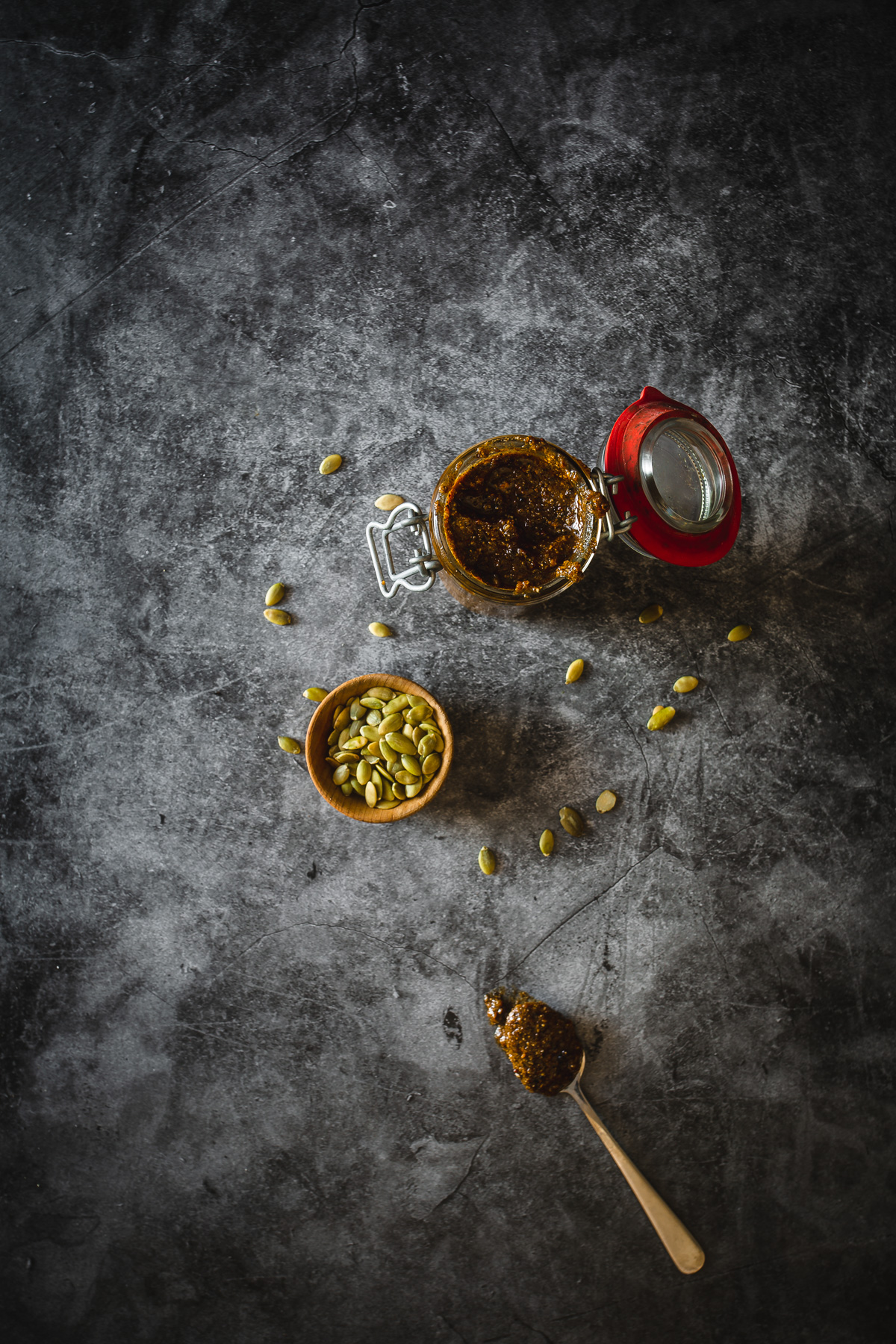pepita salsa with pumpkin seeds and spoon