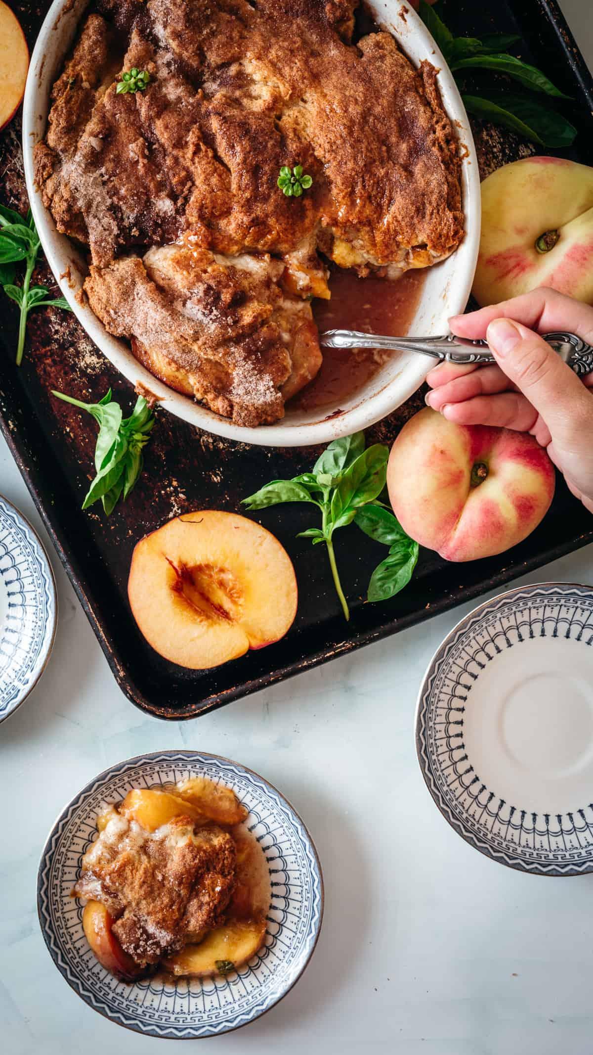 serving gluten free peach cobbler