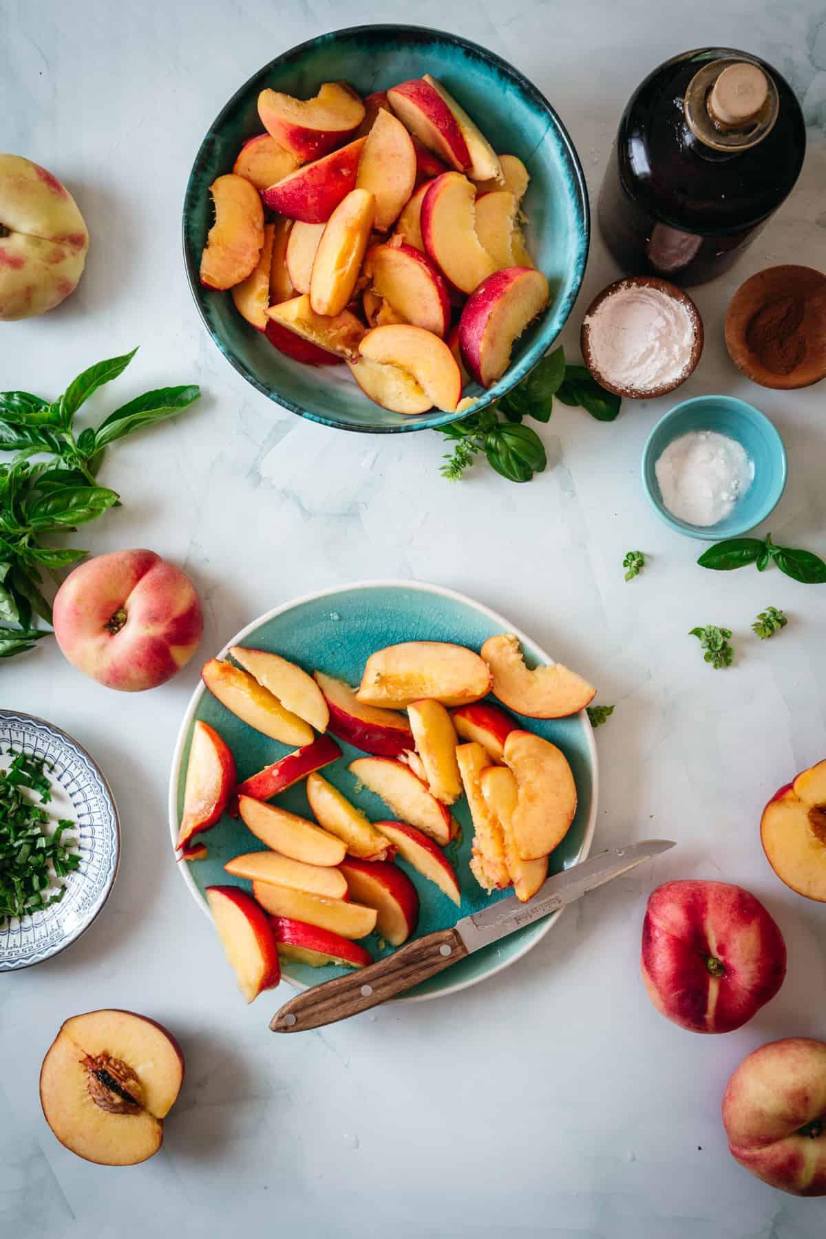 sliced peaches and basil
