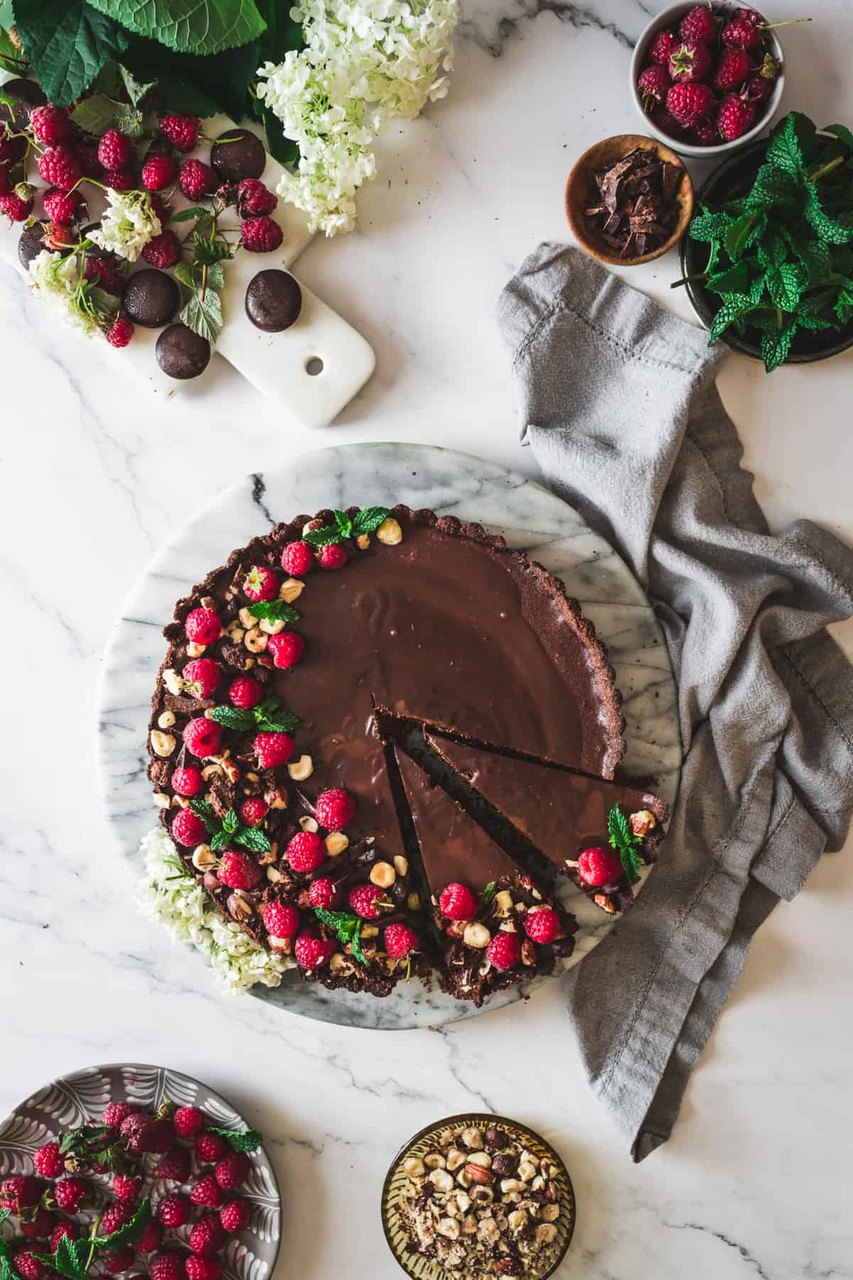chocolate raspberry tart with two slices cut