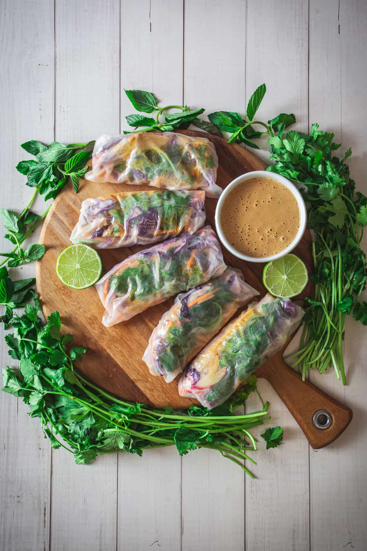 platter of spring rolls with herbs