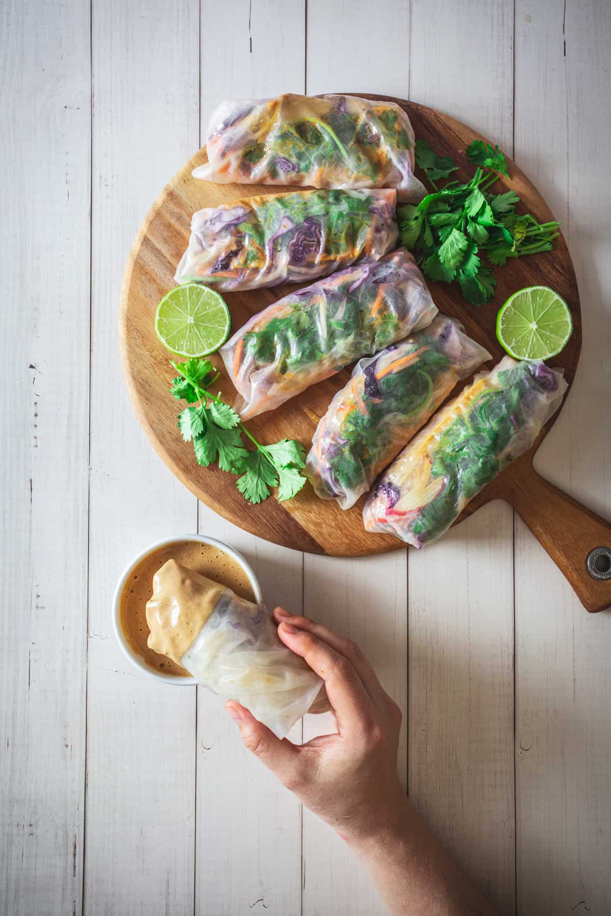 dipping spring roll into sauce