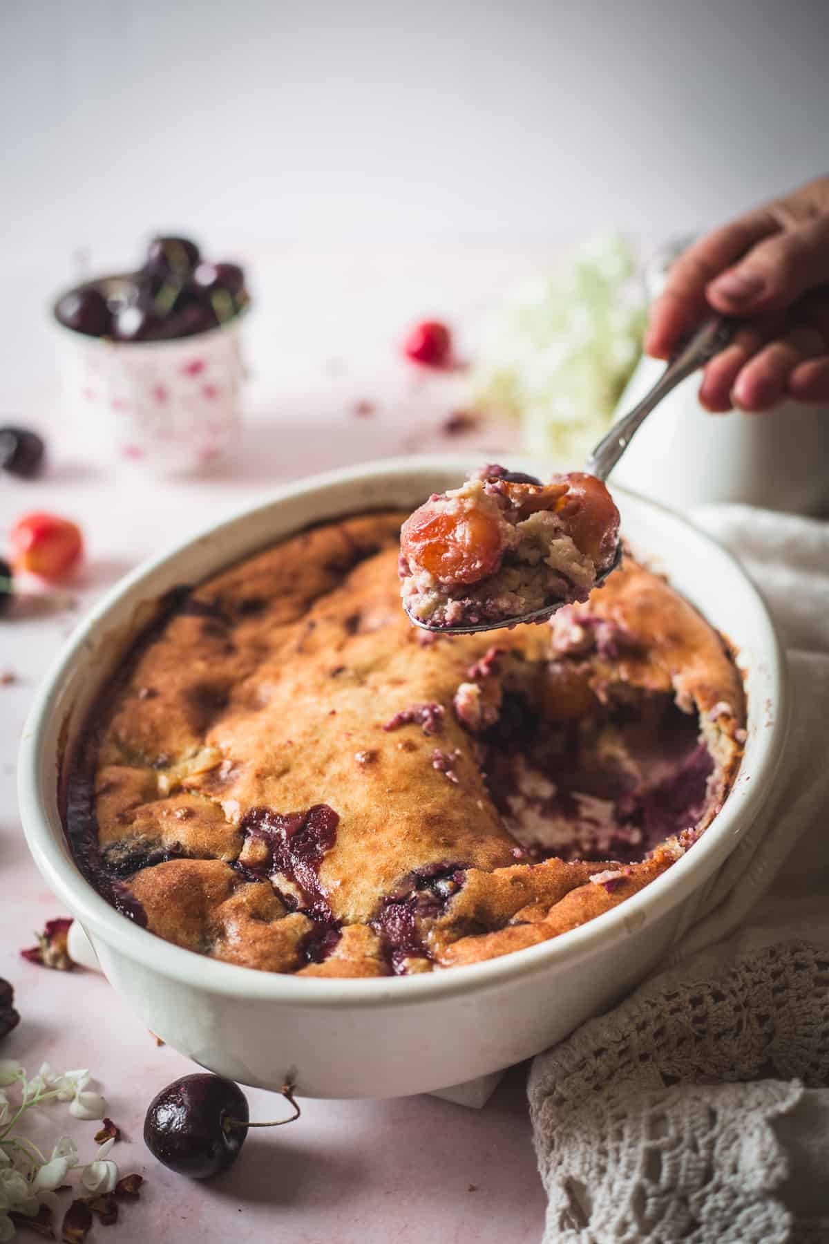 gluten free cherry cobbler with serving spoon