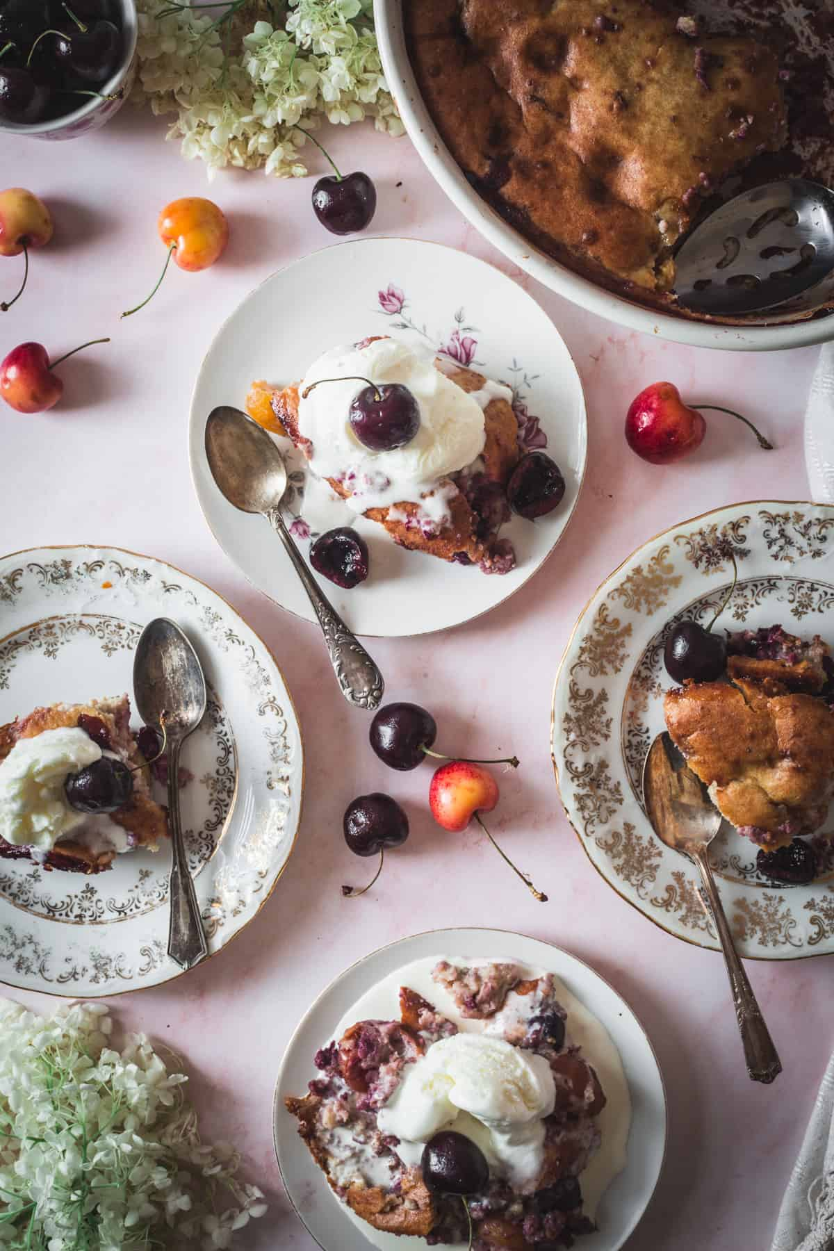 four plates of cherry cobbler